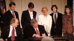 Brady is next to President Bill Clinton as Clinton signs the Brady Bill on November 30, 1993. The bill, which was fiercely fought over for y...
