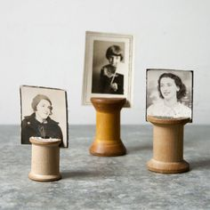 Wooden spools repurposed into picture holders.
