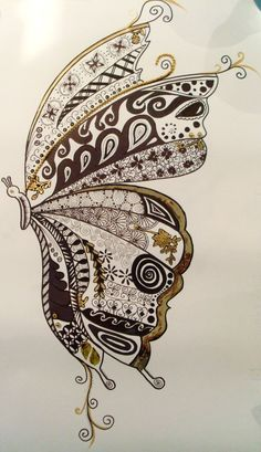 done using black ink felt tin pens, gold paint, gold curling ribbon and beads.