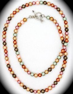 Multi-colored pearl necklace w/sterling heart toggle.