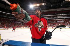 SUNRISE, FL - APRIL 13: George Parros #22 of the Florida Panthers squirts fans with water prior to the start of the game against the Pittsburgh Penguins at the BB Center on April 13, 2013 in Sunrise, Florida. (Photo by Eliot J. Schechter/NHLI via Getty Images)