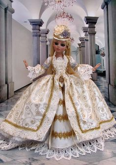 Outfit for 16  Ellowyne consists of: MHD inc designs Madame du Pompadore dress in cream and gold and silver. The outfit is an Overdress, an Underskirt and a set of Pantaloons with  hips  to hold the d
