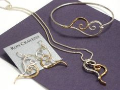 Ron Cravens silver and gold heart set