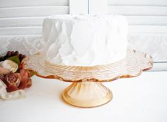 A personal favorite from my Etsy shop https://www.etsy.com/listing/544671004/rose-gold-pink-depression-glass-cake