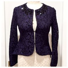 """Black and Navy Peplum Lace Jacket Black and navy peplum lace jacket by Heed (Nordstrom). High-lo peplum style with narrow emphasis at high part of waist. Fits petites well (I'm 5""""1'). Black beads at neck. Four hook and eye closures for many styling options. Sleeves have been shortened; note measurements. Sleeves (shoulder seam to wrist): 21.5 and 22 inches. Approx 34 inch bust, 31 inch waist. Excellent condition with no tears or pulls. Dry clean. TRADE Nordstrom Jackets & Coats Blazers"""