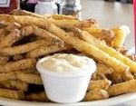 Hyde Park Bar & Grill. They have these french fries you see in the photo. They're BATTERED and then fried and the calories don't count. The rest of the food is just as good. Highly recommend the chicken fried chicken.