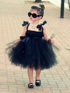 Love this little girl. If I have a neice this will one day be her halloween costume!