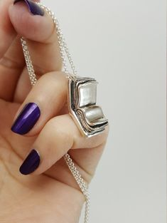 This unique silver book necklace is fully 3-dimensional. It is designed to look like an old journal with a strap which actually forms the bail on the back. Perfect gift for a book lover! _____________________________ Every piece I make is handcrafted in solid sterling silver! I design,