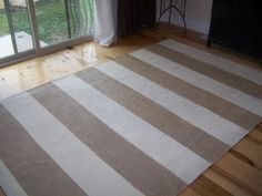 DIY drop cloth rug. $12 for drop cloth + leftover latex paint + sealed with poly leftover from furniture project