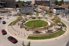The Circle in Uptown Normal, IL. is a multi-functional public space located in a roundabout that provides community green space, re-circulates storm water into a public fountain and improves traffic circulation.