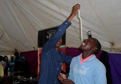 Unbelievable! South African Pastor Penuel Mngunimakes his followers swallow live snake during deliverance—Take a Look! - http://www.nollywoodfreaks.com/south-african-pastor-penuel-mnguni-makes-his-followers-swallow-live-snake-during-deliverance/