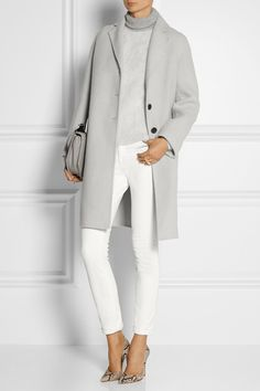 white jeans and wool-blend coat.