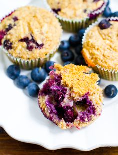 Ginger-Lemon Blueberry Banana Oat Muffins from Healthy. Happy. Life. Bursting with oats, fruit, nuts and seeds, one of these makes a delicious, healthy and convenient breakfast. Vegan and flour-free!
