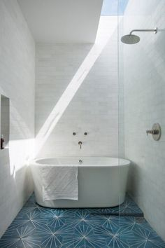 tub + shower with tiny glass partition 12 Bathrooms Where Tile is the Star of the Show