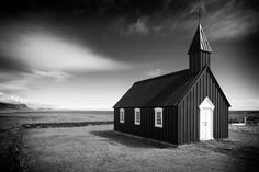 Budir church in Iceland, black and white photograph. Available as poster, fine art print or canvas print with 30 days money back guarantee. (c) Matthias Hauser hauserfoto.com