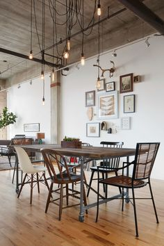 "Around a rustic <a href=""https://www.restorationhardware.com/catalog/product/product.jsp?productId=prod3070161&categoryId=cat2200077"" target=""_blank"">dining table on casters</a>, the group collected an eclectic mix of mismatched chairs from Etsy. Hanging over head, is an <a href=""http://www.hangoutlighting.com/products/custom-antique-9-swag-pendant-chandelier"" target=""_blank"">Edison bulb chandelier</a>. Jen spent an evening perfectly positioning each bulb to create a pattern that would delin..."