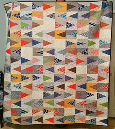 Sew E.T.: A Quilt for a Dude: Which Direction?  ..the backgrounds are low volume neutrals and the triangles contrast beautifully!  Love the color combo!