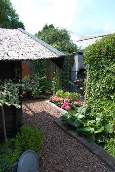 Een sfeerhoekje van onze tuin....,