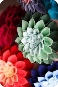 Felt flower corsage - upcycle craft idea ; direction for the felt dahlia , the link is at the bottom of the post  : http://news.holidash.com//2010/04/23/mothers-day-corsage/