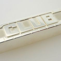 A life-sized silver 'Club' biscuit ornament