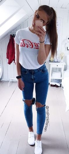 #fall #outfits women's white and red Coca-Cola printed shirt and blue denim jeans