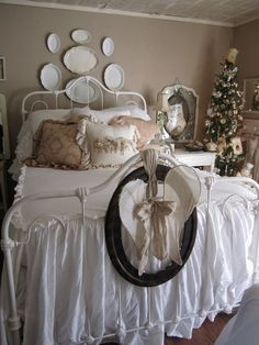 You gotta love Ann's gorgeous bed and bedding and the sweet tree beside and the collage behind domed glass and aren't the framed angel wings just so wonderful? More pictures at Theresa's blog here: http://gardenantqs.blogspot.com/