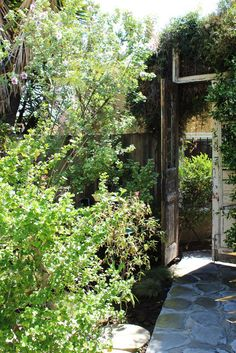 Mysterious!!  Love the tall double doors used as a fence gate. (Home of Better Shelter's Steve Jones, as featured on Apartment Therapy house tour.)
