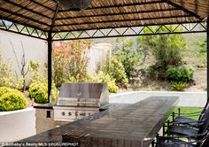 Summer parties: The outdoor area boasts a barbecue pit ...