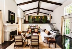 Mezzanine in living room with ceiling beams.