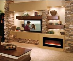 """50"""" Ethanol Fireplace, crystal rocks. This wall arrangement of fplc, shelving, stone is stunning."""