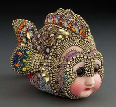 Betsy Youngquist, multi media artist who creates sculptural mosaics using beads and antique porcelain doll parts #womensart