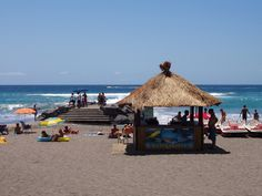 The perfect beach scene - straw thatched huts, pedalos, soft sand and aquamarine seas - this is serious chillout in the sun territory. Beach Scenes, Tenerife, Costa, Cabin, Holidays, House Styles, Outdoor Decor, Travel, San Miguel