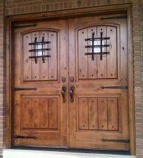 Rustic knotty alder entry doors with sidelights clearance for Double door wooden door