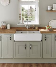 With our Lamona Double Ceramic Belfast sink, not only is this traditional sink very pleasing to the eye and in keeping within the culture of a laundry cupboard it has double the sink space, which is i Sage Green Kitchen, Green Kitchen Cabinets, Kitchen Paint, Home Decor Kitchen, Kitchen Interior, New Kitchen, Kitchen Sinks, Green Country Kitchen, Kitchen Ideas