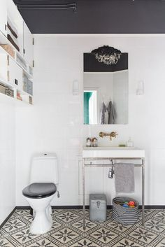 Come away with me while I dream ofa lovely bathroom where I could pamper and relax; with white tiles, patterned floors and minimal accessories