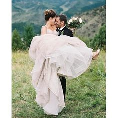 This @watterswtoo gown swept us of our feet like how he swept this bride (@annabedenver) off hers. Photo by @ashleysawtelle #Watters #Wattersbridal #watterswtoo #realbride #photo #specialmoment #reallove #love #mountainview #weddinginspiration #weddingsdr