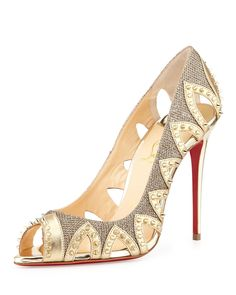 "Christian Louboutin metallic fabric pump with leather trim. 4"" metallic heel. Peep toe. Triangular cutouts with spike trim. Signature red leather outsole. ""Circus City"" is made in Italy."