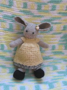 Lovely knitted bunny girl with 2 dresses by dollsandbunnies