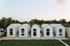 """The series of pitched white buildings was inspired by the work of architect Hugh Newell Jacobsen. """"The shell of the house is a very simple form,"""" says Matthew Ford, """"no turns or intersecting roof sections. This allowed me to use solid but inexpensive framing and roofing crews. We are always looking for the point where simplicity and luxury meet."""" Photo by: Jack Thompson"""