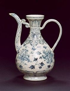 Vietnamese blue and white ewer - Late 15th/early 16th century The pear-shaped body boldly painted with peony blossoms and leafy scrolls between a band of large petal lappets below and a stylised ruyi-shaped leafy lappet above, the neck painted with stiff leaves above a band of chrysanthemum scrolls (old repair). 15cm (9¾in) high.
