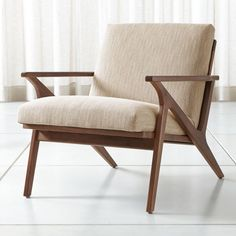 Shop Cavett Wood Frame Chair. The Cavett chair's slight recline angles you back comfortably with supportive cushions upholstered in a polyester basketweave that layers varied tones of brown. The Cavett Chair is a Crate and Barrel exclusive.