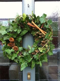 Foliage wreath - such a welcoming sign - so is a scented house Christmas Classroom Door, Christmas Front Doors, Christmas Door Wreaths, Christmas Door Decorations, Holiday Wreaths, Christmas Pops, Christmas Flowers, Deco Floral, Arte Floral