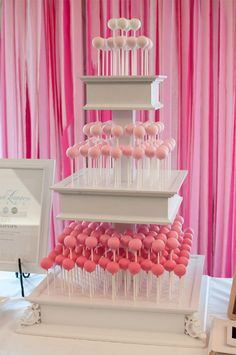 Cake Pop display, love it! I could see the same design with rustic boards for a whole new look.