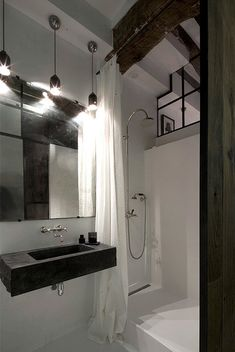 Open shower with curtain, all over white tile, large mirror Festen
