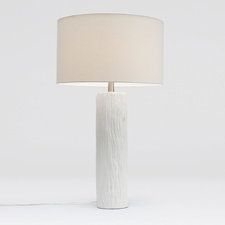 Russell is a versatile and beautiful piece. Wood-grain is captured in ceramic, then finished in silver, gold or white. Finished with a white linen drum shade.