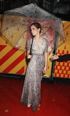 Emma Watson looks stunning with her large Clear Umbrella!