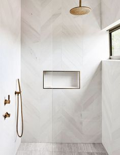 luxury bathroom Decor modern A Treetop Apartment In Noosa modern bathroom with modern white herringbone tile in walk in tile shower, white tile shower wiht gold shower head, minimalist bathrooom decor White Tile Shower, Gold Shower, Master Shower Tile, Shower Orange, Marble Tile Shower, Tile Walk In Shower, Marble Look Tile, Window In Shower, Modern Bathroom Design