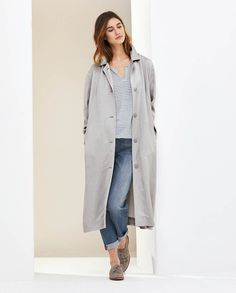 Poetry - Soft drapey coat - In slinky silky viscose with its lovely soft drape this full-length summer trench coat is sophisticated and elegant. Traditional tailoring details with a full-length, buttoned placket a fabric belt and two jetted side pockets. 64% viscose 15% rayon 21% linen