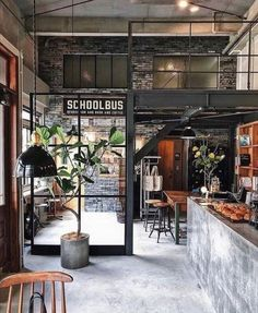 The Industrial Loft is the ideal type of housing for seeking practicality and style. Industrial Coffee Shop, Loft Industrial, Industrial Interiors, Coffee Shop Interior Design, Coffee Shop Design, Restaurant Interior Design, Industrial Restaurant Design, Brewery Interior, Pub Interior
