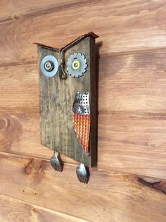 Mixed media Owl. Made from old oak fence board, copper grounding braid pieces, vegetable steamer, machinist cutting bit, bottle opener beak, washer, forks, and a bronze mini wire wheel. JH